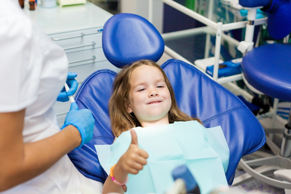 Town & County Dental Care pediatric dentistry happy kid on clinic