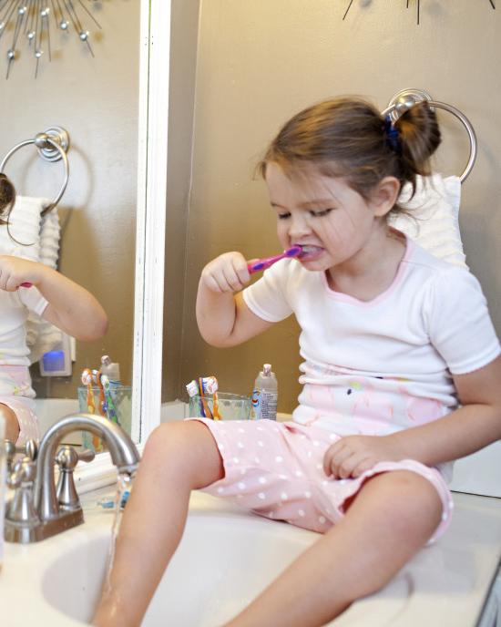 Town & County Dental Care pediatric dentistry kid broushing their teeth in-the-bathroom-at-home-at-bedtime_